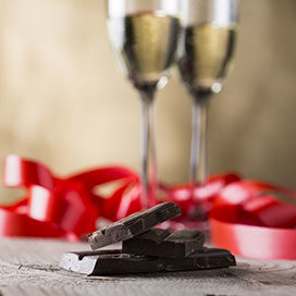 chocolate and two champagne glasses with red ribbon